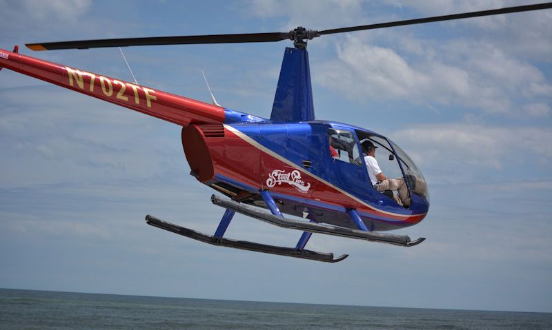 Robinson R44 helicopter ride over water