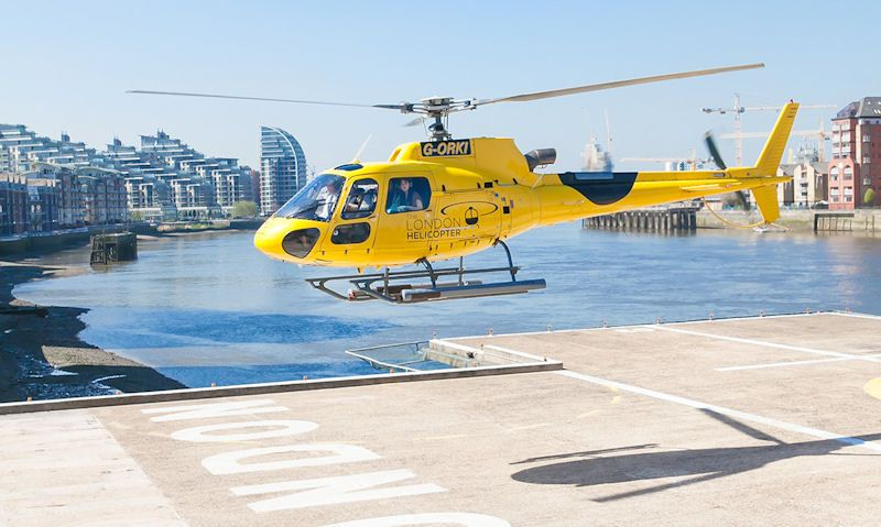 Helicopter taking off at Edmiston London Heliport, London