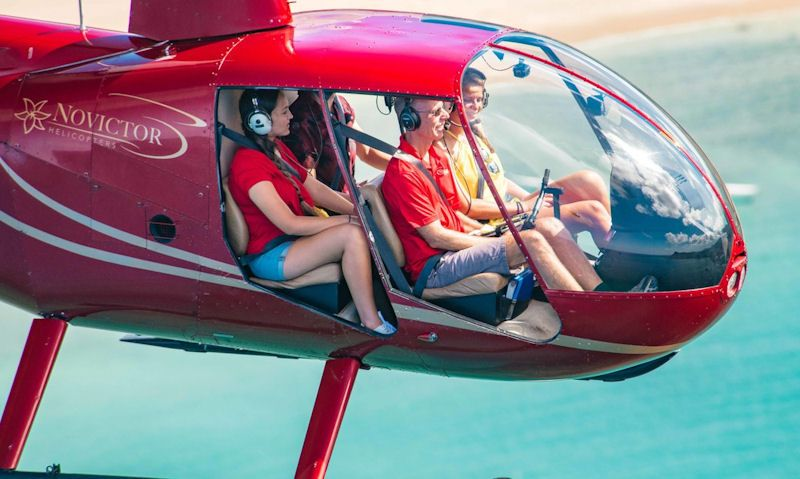 Novictor Helicopter with passengers seen onboard in flight