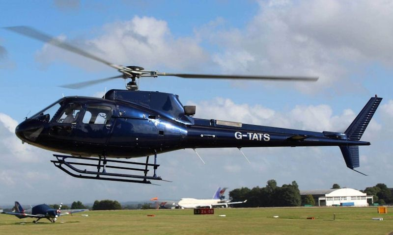 Airbus H125 helicopter in flight with passengers