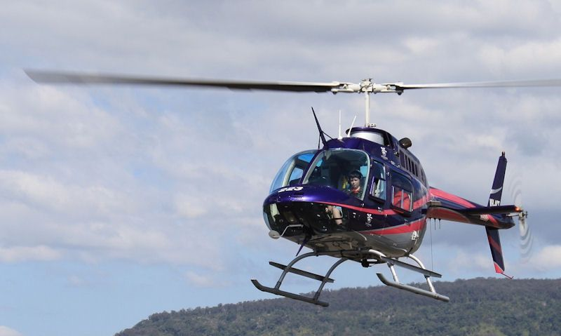 Passengers seen in Bell JetRanger helicopter