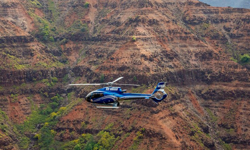 Blue Hawaiian tour helicopter flying in Waimea Canyon