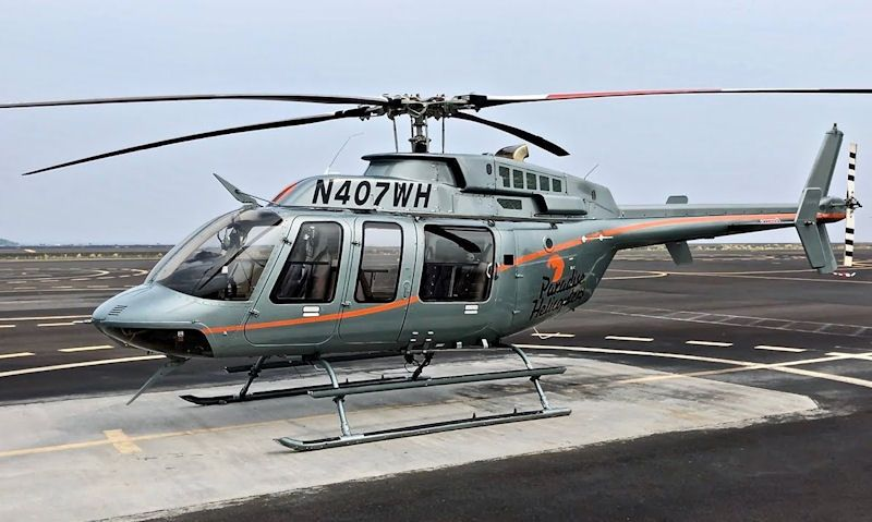 Paradise Helicopters Bell 407 sitting on Hilo Heliport
