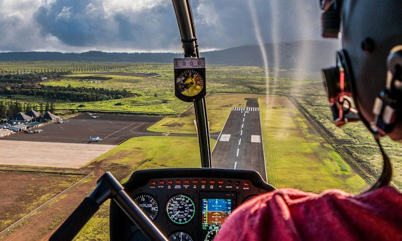 Rear seat view approaching Lanai Airport in Robinson R44 helicopter