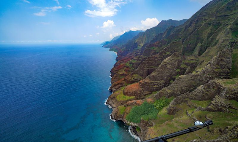 Doors off Robinson R44 helicopter viewing the Na Pali Coast
