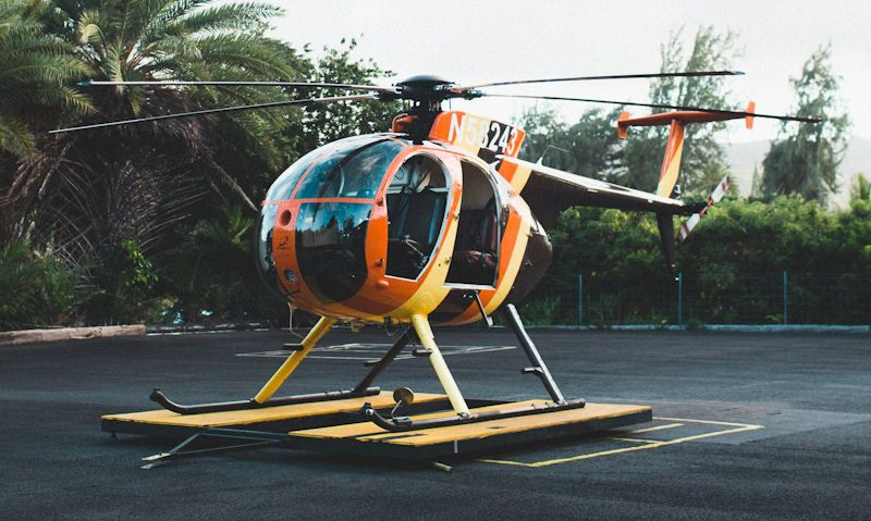 Oahu's Magnum Helicopter situated on a dolly, positioned on tarmac