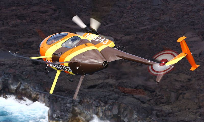 Paradise Helicopters replica MD 500D maneuvering above Oahu coastline