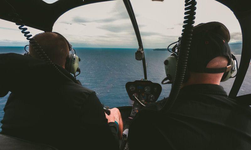 Passenger, pilot seen in Robinson R44 over Maui water