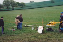 standing next to r/c helicopter display