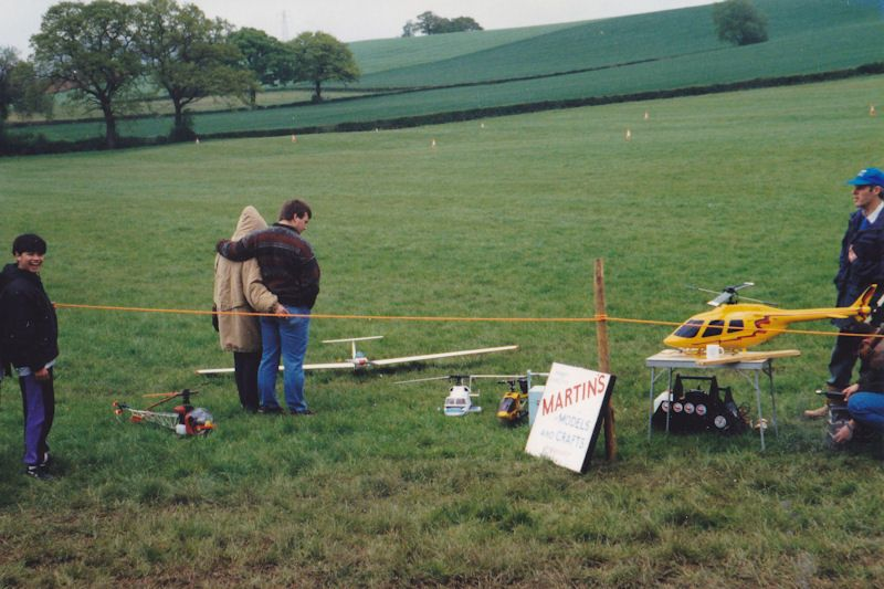 me standing next to R/C helicopter display
