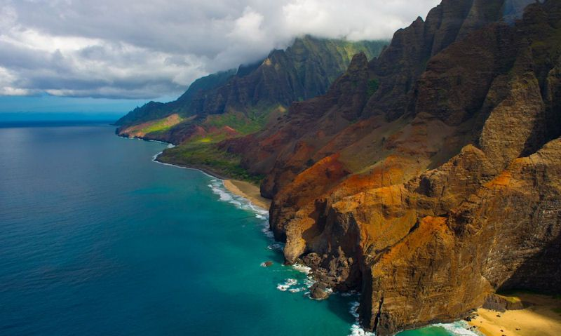 Arial photograph of Na Pali Coast with cliff, beaches, clear blue water in sight