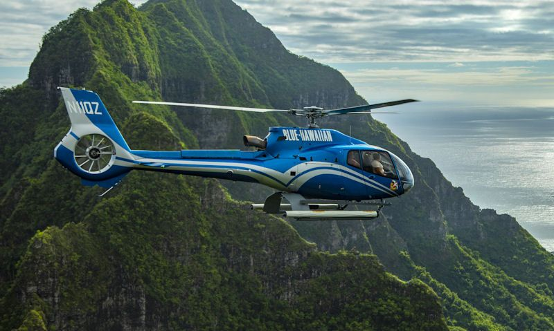 Blue Hawaiian Helicopter with passengers onboard in flight over Oahu