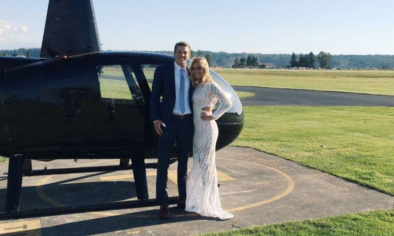Prom dates pose for picture next to Robinson R44 at airfield departure