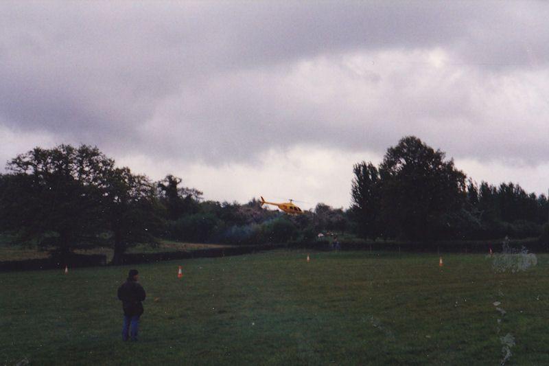 Overcast darkens sky well R/C heli is in flight