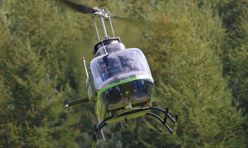Passenger seen in Bell JetRanger helicopter buzz flight off the ground